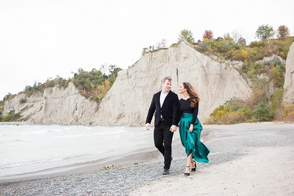 engaged couple walking Scarborough Bluffs Engagement